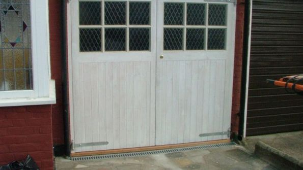 Timber Side Hinged with Window swith Hardwood Threshold.